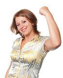 Smiling girl shakes the fist lifted upwards Stock Photography