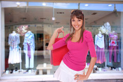 Smiling girl is shopping Stock Photo