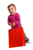Smiling girl with a shopping bag stock photo