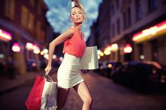 Smiling girl with shopping bags Stock Image
