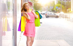 Smiling girl with shopping bags Royalty Free Stock Photography