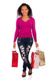 Smiling girl with shopping bags Stock Photography