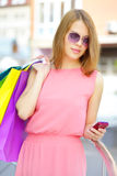 Smiling girl with shopping bags Stock Photos