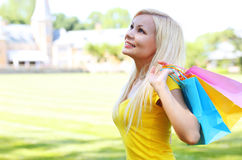 Smiling girl with shopping bags. Outdoors Stock Photo