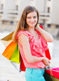 Smiling Girl After Shopping Royalty Free Stock Image