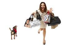 Smiling girl on shopping Stock Photos