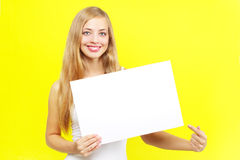 Smiling girl showing blank card Royalty Free Stock Image