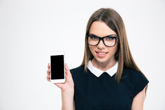 Smiling girl showing blank smartphone screen Royalty Free Stock Images