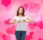 Smiling girl showing heart with hands Stock Image
