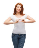 Smiling girl showing heart with hands Royalty Free Stock Photography