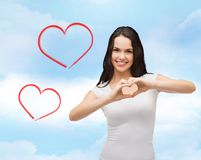 Smiling girl showing heart with hands Royalty Free Stock Image