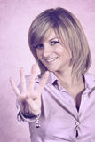 Smiling girl showing number four with fingers Stock Photography