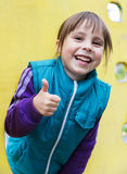 Smiling girl showing ok out of the window at the Royalty Free Stock Images
