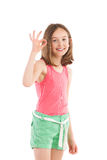 Smiling girl showing ok sign Royalty Free Stock Photos