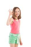 Smiling girl showing ok sign. Three quarter length studio shot isolated on white Royalty Free Stock Photos