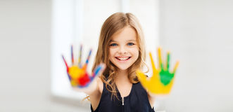 Smiling girl showing painted hands Stock Photo