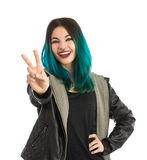 Smiling girl showing the peace sign Stock Photos