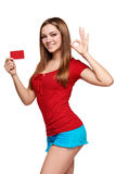 Smiling girl showing red card in hand Stock Photography