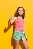Smiling girl showing thumb up Royalty Free Stock Photo