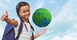 Smiling girl showing thumb up with low poly earth in background Stock Image