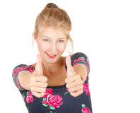 Smiling girl showing thumbs up Stock Photography