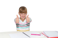 Smiling girl showing thumbs up isolated Royalty Free Stock Images