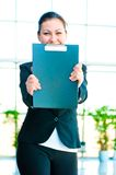 Smiling girl shows the empty office folder Stock Images