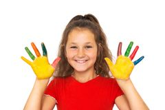 Smiling girl shows painted hands with colorful paints. royalty free stock image