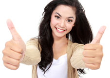 Smiling girl shows two thumbs up Royalty Free Stock Photography