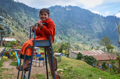 Smiling Girl Sits on Broken Slide in Guatemala stock photography