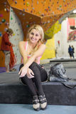 The smiling girl sits with climbing equipment Royalty Free Stock Photos
