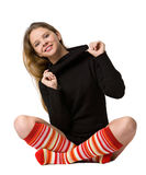 Smiling girl sits on the floor Royalty Free Stock Photo
