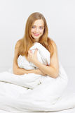 Smiling girl sitting on the bed Royalty Free Stock Image