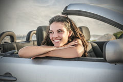 Smiling girl sitting in a car Royalty Free Stock Photos