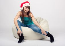 Smiling girl sitting in a chair Stock Image
