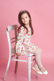 Smiling girl sitting on chair in room Royalty Free Stock Images