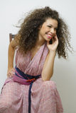 Smiling girl sitting on a chair Stock Photography