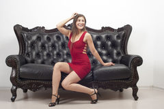 Smiling girl sitting on the couch. Smiling girl sitting on the sofa Royalty Free Stock Photo