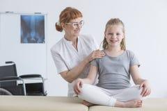 Girl sitting on rehabilitation bed stock images
