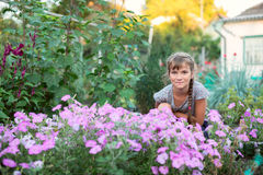 Smiling girl sitting in the garden Royalty Free Stock Photo