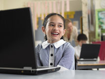 Smiling Girl Sitting By Laptop In Classroom Stock Photos