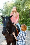 Smiling girl sitting in the saddle Royalty Free Stock Image