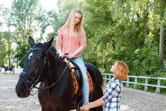 Smiling girl sitting in the saddle Royalty Free Stock Photography