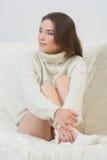 Smiling girl sitting on sofa Stock Photography