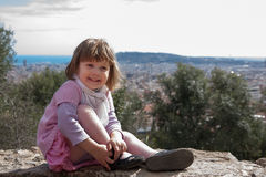Smiling girl sitting in spring park stock photography