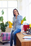 Smiling girl sitting on table and holding mop and splash Stock Images