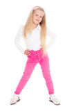 Smiling girl six years in pink jeans. Royalty Free Stock Photo