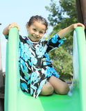 Smiling girl on a slide Stock Photo