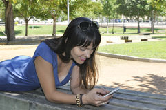 Smiling girl with smartphone Stock Photography