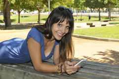 Smiling girl with smartphone Stock Photo
